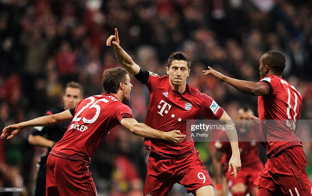 Robert Lewandowski of Bayern Munich celebrates scoring his 1st goal during the Bundesliga match between FC Bayern Muenchen and VfL Wolfsburg at Allianz Arena on September 22, 2015 in Munich, Germany.