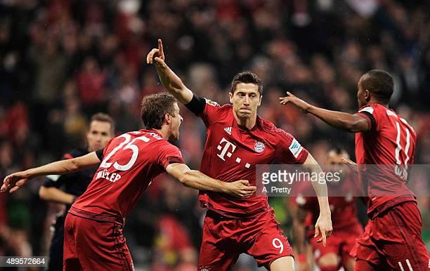 Robert Lewandowski of Bayern Munich celebrates scoring his 1st goal during the Bundesliga match between FC Bayern Muenchen and VfL Wolfsburg at...