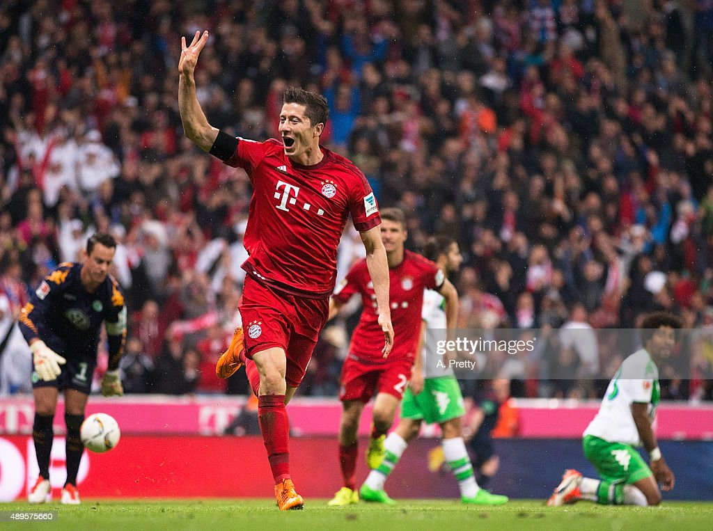 Robert Lewandowski of Bayern Munich celebrates scoring his 4th goal during the Bundesliga match between FC Bayern Muenchen and VfL Wolfsburg at Allianz Arena on September 22, 2015 in Munich, Germany.