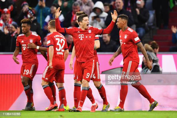 Robert Lewandowski of Bayern Munich celebrates scoring his teams first goal of the game during the Bundesliga match between FC Bayern Muenchen and 1...