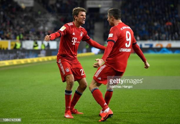 Robert Lewandowski of Bayern Munich celebrates scoring the 3rd Bayern Munich goal with Thomas Mueller of Bayern Munich during the Bundesliga match...