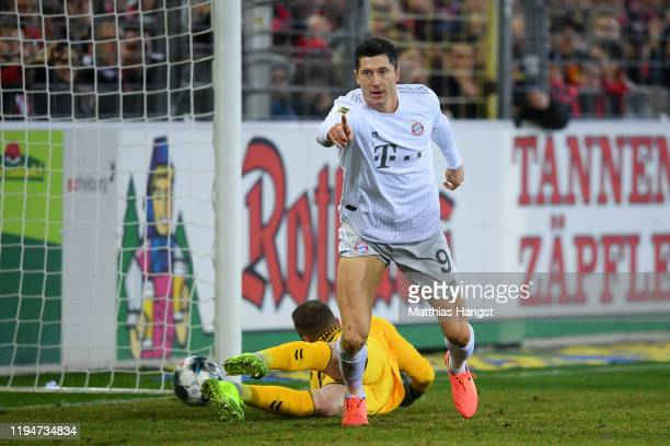 Robert Lewandowski of Bayern Munich celebrates scoring the opening goal during the Bundesliga match between Sport-Club Freiburg and FC Bayern...