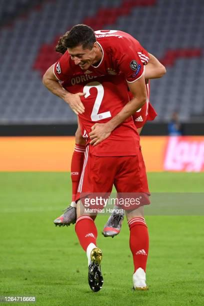 Robert Lewandowski of Bayern Munich celebrates with Alvaro Odriozola Arzallus of Bayern Munich after scoring his sides fourth goal during the UEFA...
