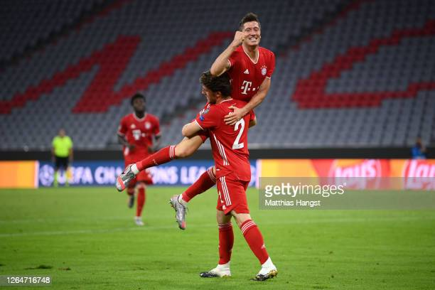 Robert Lewandowski of Bayern Munich celebrates with Alvaro Odriozola Arzallus of Bayern Munich after scoring his sides fourth goal during the UEFA...