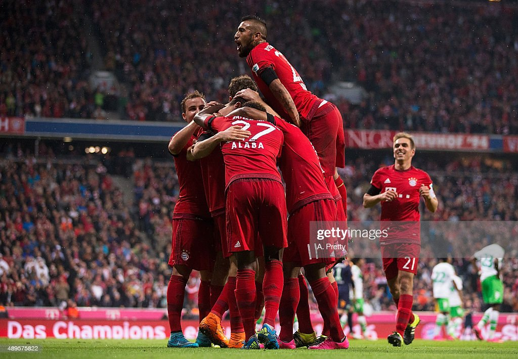 Robert Lewandowski of Bayern Munich celebrates with Arturo Vidal of Bayern Munich after scoring his 4th goal during the Bundesliga match between FC Bayern Muenchen and VfL Wolfsburg at Allianz Arena on September 22, 2015 in Munich, Germany.