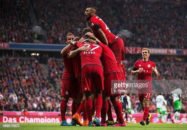 Robert Lewandowski of Bayern Munich celebrates with Arturo Vidal of Bayern Munich after scoring his 4th goal during the Bundesliga match between FC...