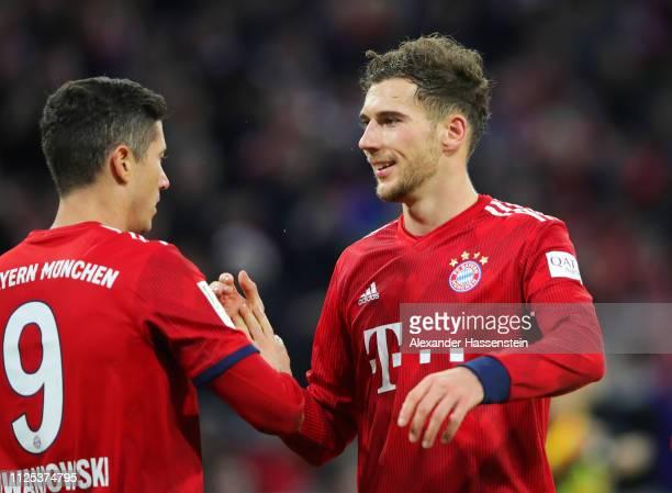 Robert Lewandowski of Bayern Munich celebrates with Leon Goretzka as he scores his team's fourth goal during the Bundesliga match between FC Bayern...