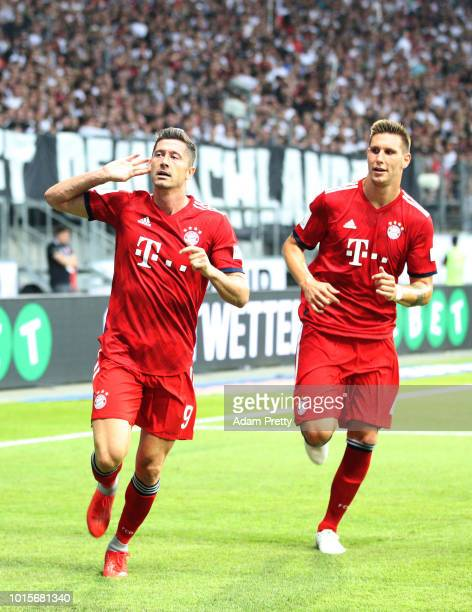Robert Lewandowski of Bayern Munich celebrates with Niklas Suele of Bayern Munich after scoring the second goal during the DFL Supercup 2018 match...