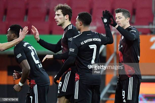 Robert Lewandowski of Bayern Munich celebrates with Serge Gnabre and teammates after scoring their team's first goal during the Bundesliga match...