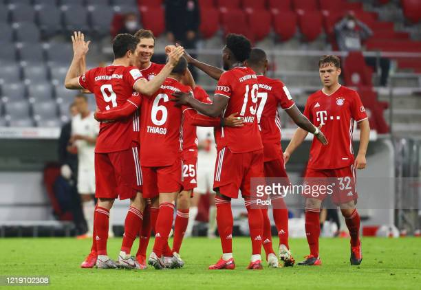Robert Lewandowski of Bayern Munich celebrates with team mates after scoring his sides second goal during the DFB Cup semifinal match between FC...