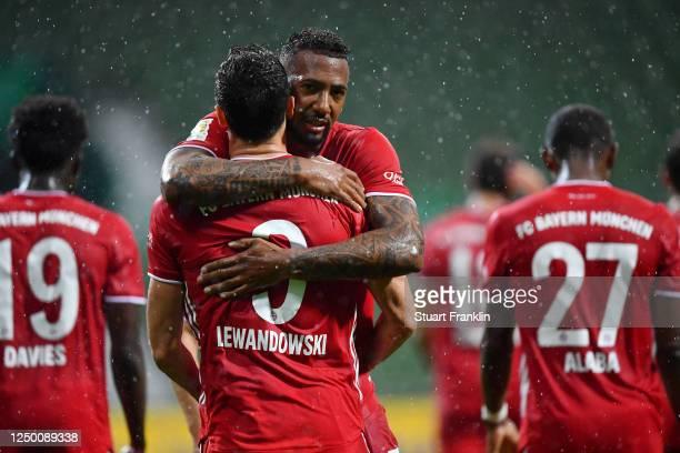 Robert Lewandowski of Bayern Munich celebrates with teammate Jerome Boateng of Bayern Munich after scoring his team's first goal during the...