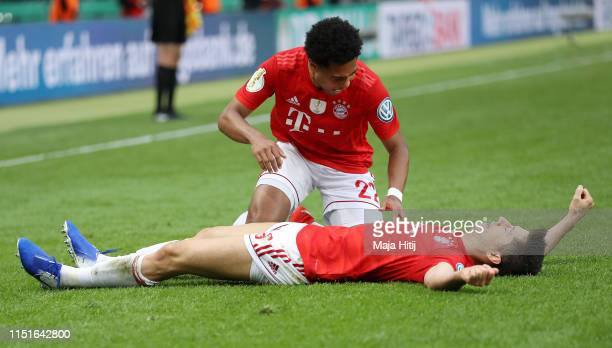 Robert Lewandowski of Bayern Munich celebrates with teammate Serge Gnabry after scoring his team's first goal during the DFB Cup final between RB...