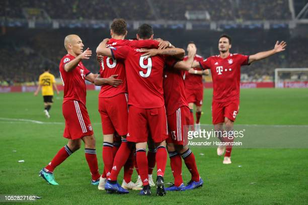 Robert Lewandowski of Bayern Munich celebrates with teammates after scoring his team's second goal during the Group E match of the UEFA Champions...