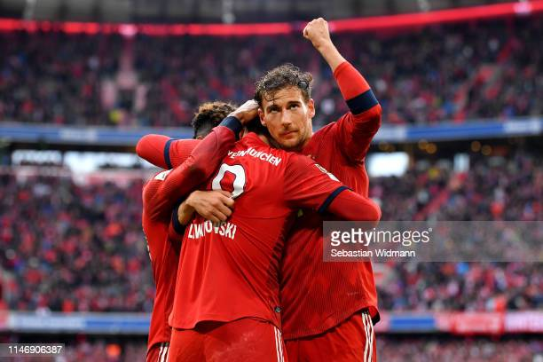 Robert Lewandowski of Bayern Munich celebrates with teammates after scoring his team's first goal during the Bundesliga match between FC Bayern...
