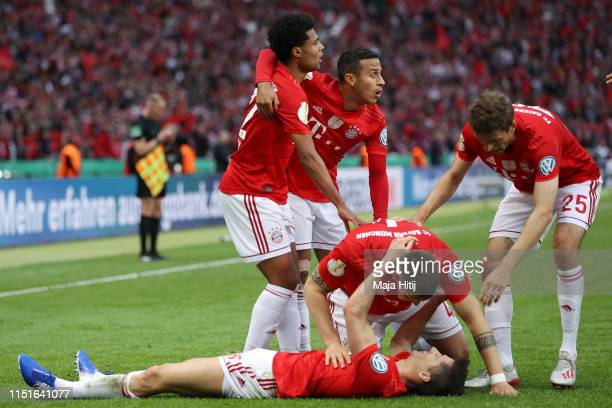 Robert Lewandowski of Bayern Munich celebrates with teammates after scoring his team's first goal during the DFB Cup final between RB Leipzig and...