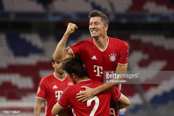Robert Lewandowski of Bayern Munich celebrates with teammates after scoring his team's fourth goal during the UEFA Champions League round of 16...