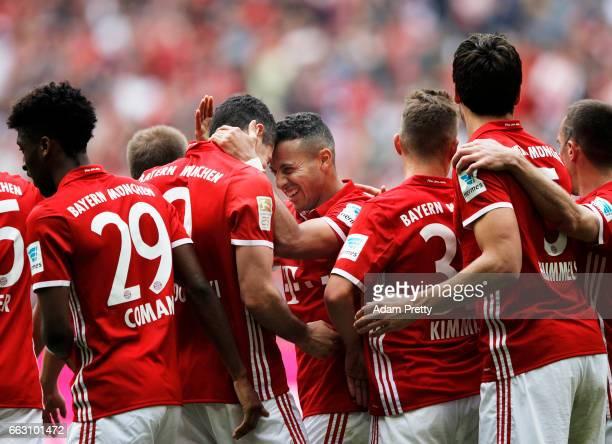 Robert Lewandowski of Bayern Munich congratulates Thiago Alcantara of Bayern Munich after scoring the fourth goal during the Bundesliga match between...
