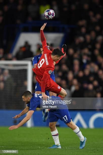 Robert Lewandowski of Bayern Munich falls over Mateo Kovacic of Chelsea during the UEFA Champions League round of 16 first leg match between Chelsea...