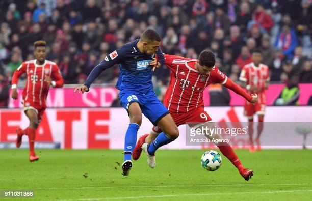 Robert Lewandowski of Bayern Munich in action against Kevin Akpoguma of 1899 Hoffenheim during a Bundesliga match between FC Bayern Munich and 1899...