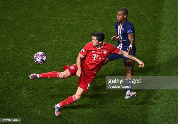 Robert Lewandowski of Bayern Munich in action against Presnel Kimpembe of PSG during the UEFA Champions League final football match between Paris...