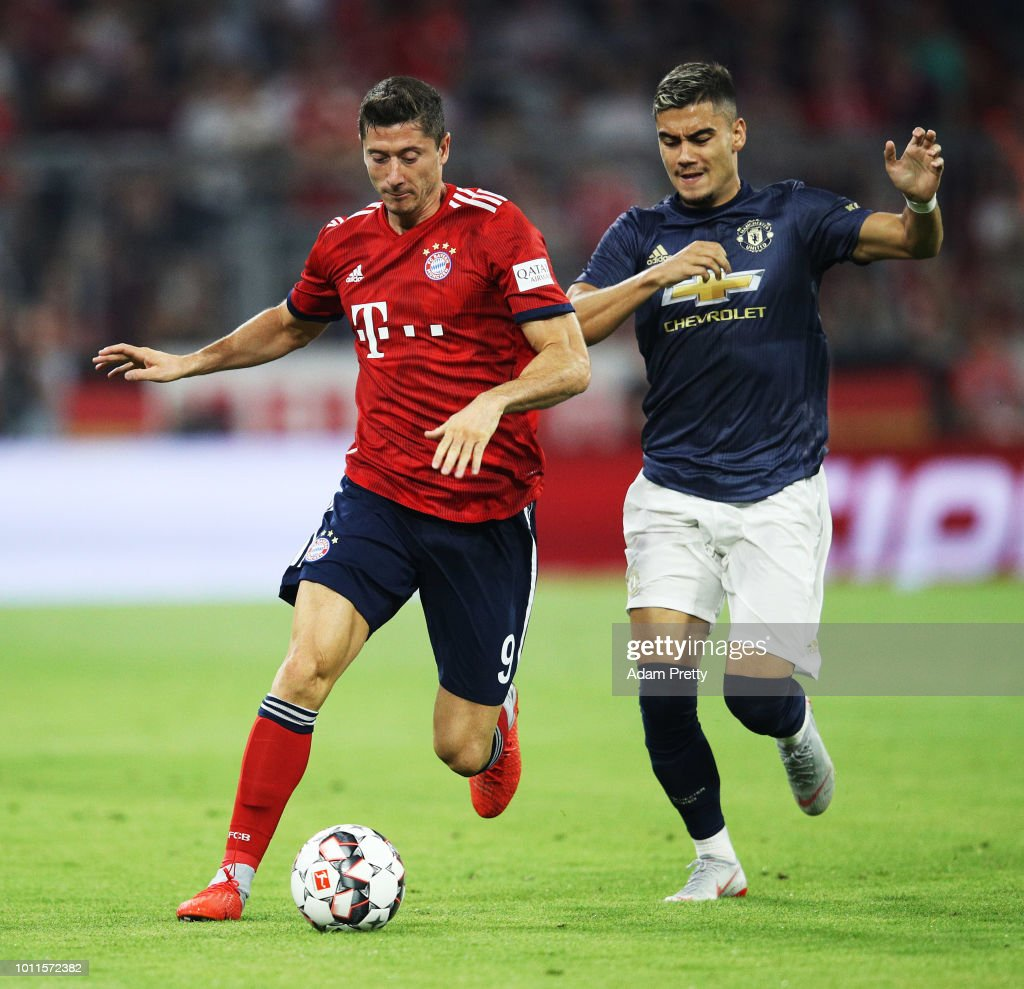 Robert Lewandowski of Bayern Munich is challenged by Andreas Pereira of Manchester United during the Bayern Muenchen v Manchester United Friendly Match at Allianz Arena on August 5, 2018 in Munich, Germany.