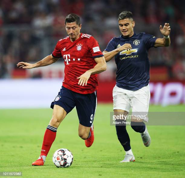 Robert Lewandowski of Bayern Munich is challenged by Andreas Pereira of Manchester United during the Bayern Muenchen v Manchester United Friendly...