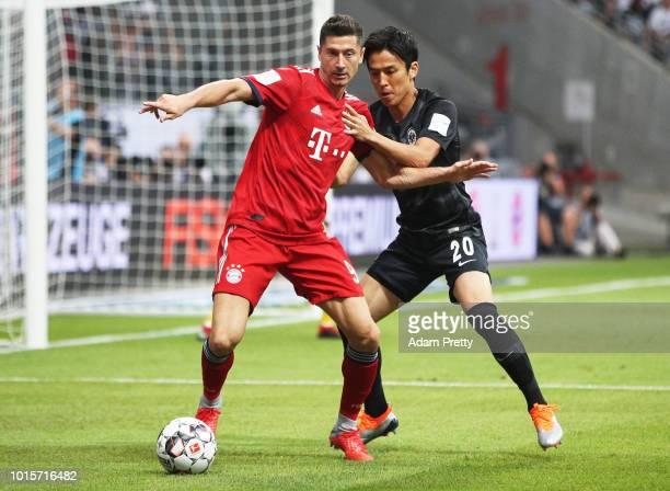 Robert Lewandowski of Bayern Munich is challenged by Makoto Hasebe of Eintracht Frankfurt during the DFL Supercup 2018 match between Eintracht...