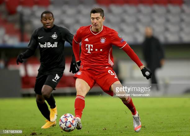 Robert Lewandowski of Bayern Munich is challenged by Mohamed Camara of RB Salzburg during the UEFA Champions League Group A stage match between FC...