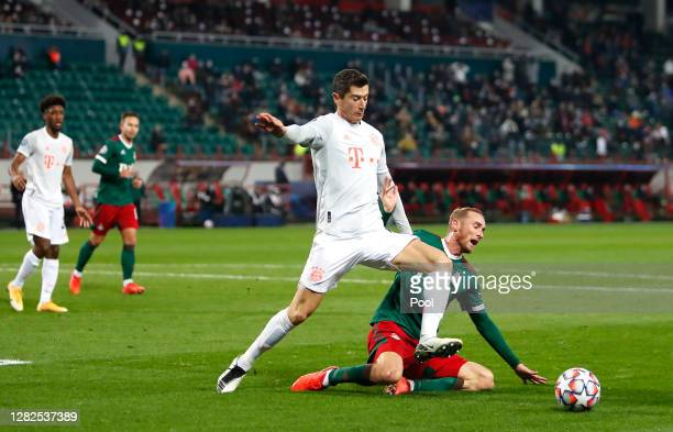 Robert Lewandowski of Bayern Munich is challenged by Vladislav Ignatyev of Lokomotiv Moscow during the UEFA Champions League Group A stage match...