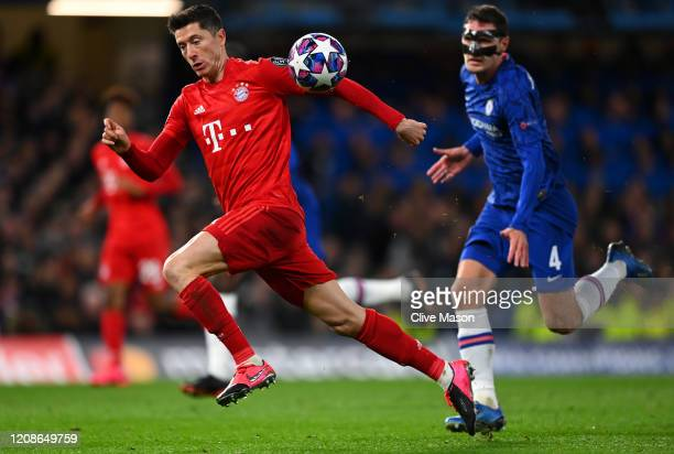 Robert Lewandowski of Bayern Munich is closed down by Andreas Christensen of Chelsea during the UEFA Champions League round of 16 first leg match...