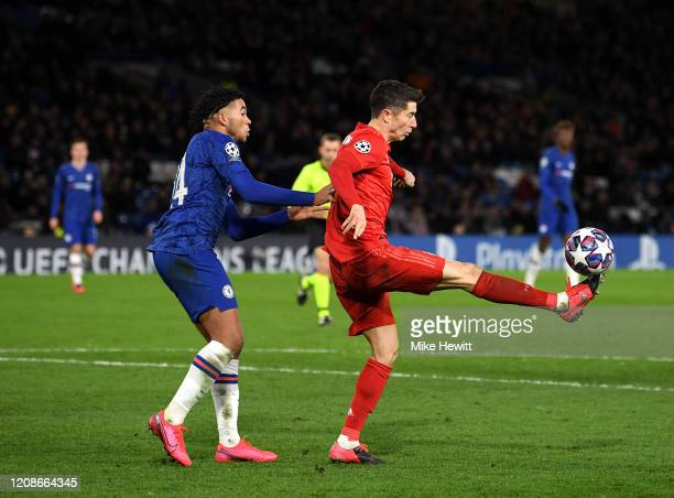 Robert Lewandowski of Bayern Munich is closed down by Reece James of Chelsea during the UEFA Champions League round of 16 first leg match between...