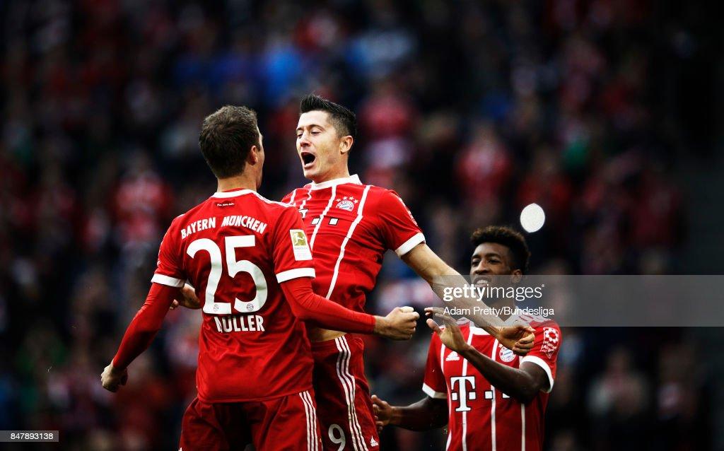 Robert Lewandowski of Bayern Munich is congratulated by Thomas Mueller after scoring a goal during the Bundesliga match between FC Bayern Muenchen and 1. FSV Mainz 05 at Allianz Arena on September 16, 2017 in Munich, Germany.