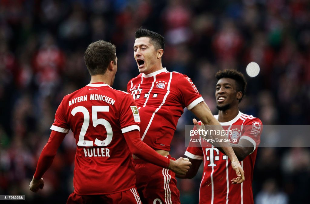 Robert Lewandowski of Bayern Munich is congratulated by Thomas Mueller after scoring a goal during the Bundesliga match between FC Bayern Muenchen and 1. FSV Mainz 05 at Allianz Arena on September 16, 2017 in Munich, Germany.