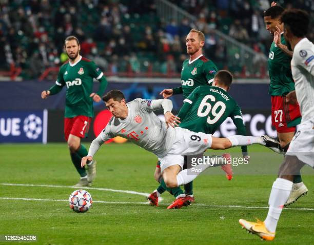 Robert Lewandowski of Bayern Munich is fouled by Daniil Kulikov of Lokomotiv Moscow leading to the awarding of a penalty which was later overturned...