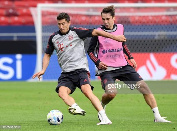 Robert Lewandowski of Bayern Munich is put under pressure by teammate Adrian Fein during a training session ahead of their UEFA Super Cup match...