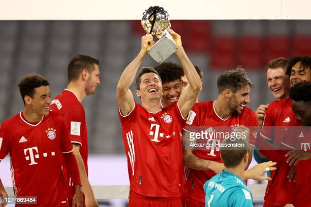 Robert Lewandowski of Bayern Munich lifts the Supercup 2020 as he celebrates with his team mates after the Supercup 2020 match between FC Bayern...