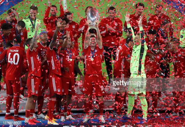 Robert Lewandowski of Bayern Munich lifts the UEFA Super Cup trophy as he and team mates celebrate victory over FC Sevilla at Puskas Arena on...