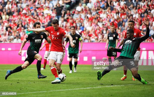 Robert Lewandowski of Bayern Munich passes to Thiago Alcantara of Bayern Munich to score the fourth goal during the Bundesliga match between Bayern...