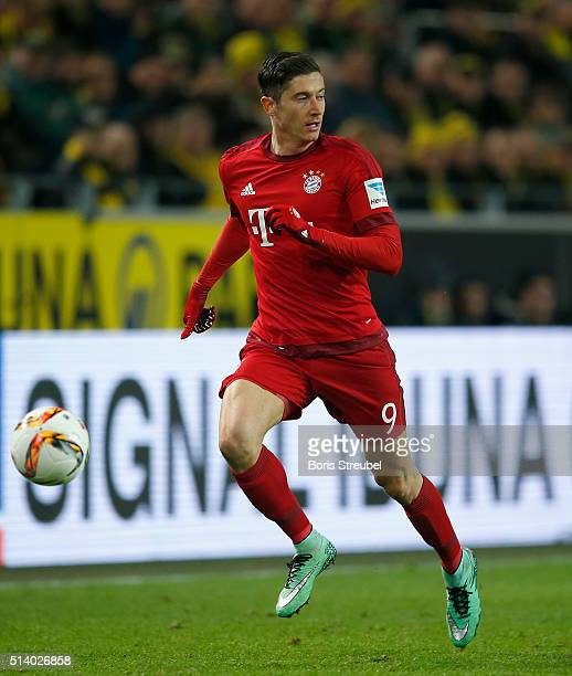 Robert Lewandowski of Bayern Munich runs with the ball during the Bundesliga match between Borussia Dortmund and FC Bayern Muenchen at Signal Iduna...