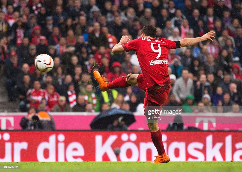 Robert Lewandowski of Bayern Munich scores his 4th goal during the Bundesliga match between FC Bayern Muenchen and VfL Wolfsburg at Allianz Arena on September 22, 2015 in Munich, Germany.