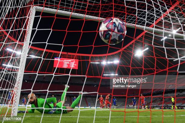 Robert Lewandowski of Bayern Munich scores his sides first goal from the penalty spot during the UEFA Champions League round of 16 second leg match...