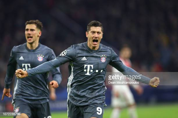 Robert Lewandowski of Bayern Munich scores his sides second goal during the UEFA Champions League Group E match between Ajax and FC Bayern Muenchen...