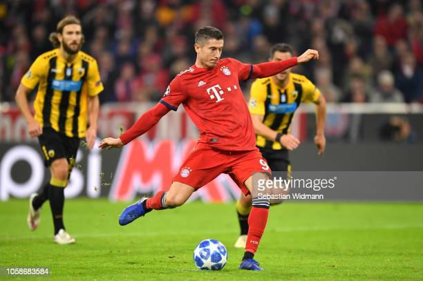 Robert Lewandowski of Bayern Munich scores his team's first goal from the penalty spot during the UEFA Champions League Group E match of the between...