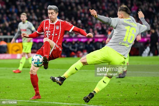Robert Lewandowski of Bayern Munich scores his team's first goal past Pawel Olkowski of 1FC Koeln to make it 10 during the Bundesliga match between...