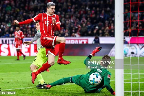 Robert Lewandowski of Bayern Munich scores his team's first goal past Timo Horn of 1.FC Koeln during the Bundesliga match between FC Bayern Muenchen...