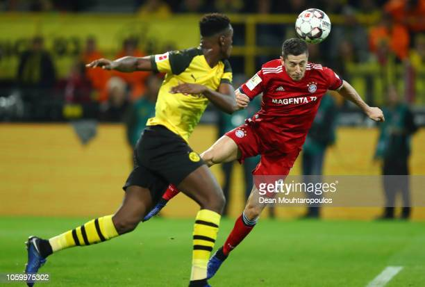 Robert Lewandowski of Bayern Munich scores his team's first goal during the Bundesliga match between Borussia Dortmund and FC Bayern Muenchen at...