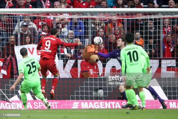 Robert Lewandowski of Bayern Munich scores his team's first goal during the Bundesliga match between FC Bayern Muenchen and Hannover 96 at Allianz...