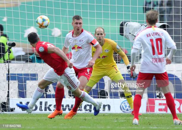 Robert Lewandowski of Bayern Munich scores his team's first goal during the DFB Cup final between RB Leipzig and Bayern Muenchen at Olympiastadion on...