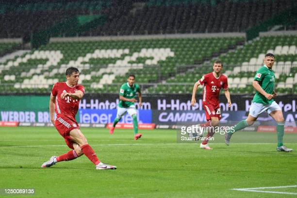 Robert Lewandowski of Bayern Munich scores his team's first goal during the Bundesliga match between SV Werder Bremen and FC Bayern Muenchen at...