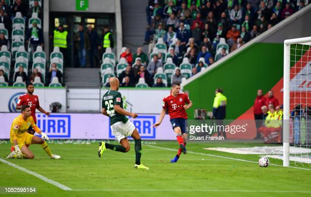 Robert Lewandowski of Bayern Munich scores his team's second goal during the Bundesliga match between VfL Wolfsburg and FC Bayern Muenchen at...